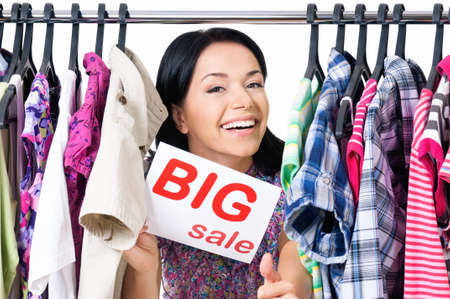 clothes rack: Shopaholic shopping woman with clothes rack, isolated on white background