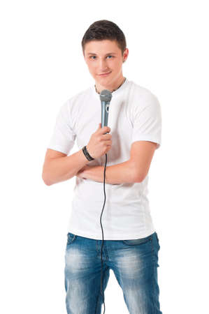 microphone: Young man reporter holding a microphone, isolated on white background Stock Photo