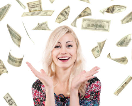 win money: Portrait of young excited woman under a money rain - isolated on white background Stock Photo