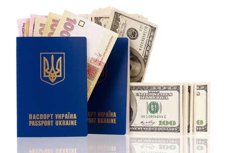 hryvna: International Ukrainian passport with Hryvna and US dollars banknotes isolated on white background