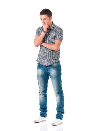 headache man: Full length portrait of young man looking thoughtful while holding his head, isolated on white background Stock Photo