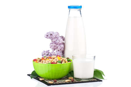 dairying: Bottle of milk with tasty cornflakes and branch lilac, isolated on white background
