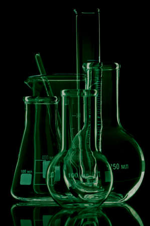 analytical chemistry: Laboratory glassware for liquids on black background