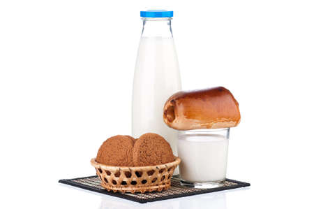 dairying: Bottle of milk, oat cookies and bun with poppy seeds, isolated on white background Stock Photo