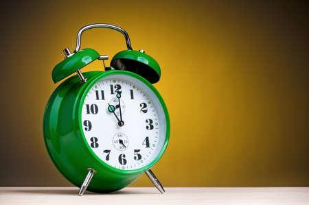 second breakfast: Big green alarm clock on dark yellow background