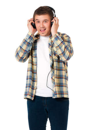 feeling happy: Young modern man with headphones isolated on white background