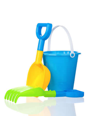 bucket and spade: Toy bucket, rake and spade isolated on white background Stock Photo