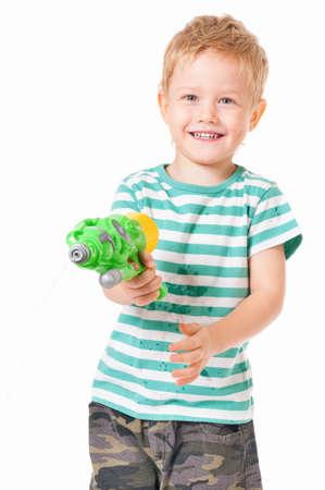watergun: Happy boy with plastic water gun isolated on white background