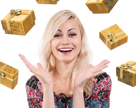 Beautiful blonde woman catching falling gifts, isolated on white background photo