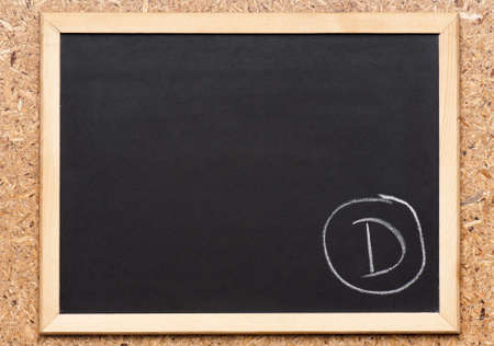 grades: Letter D written on chalkboard, getting bad grades Stock Photo