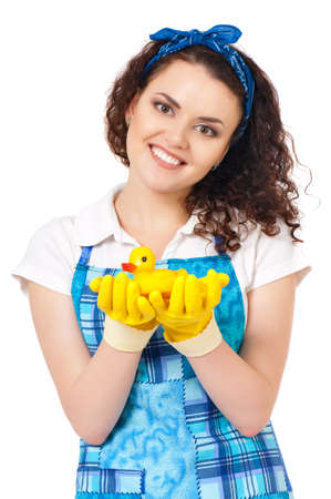 toy toilet bowl: Young housewife with yellow gloves and yellow rubber duck, isolated on white background Stock Photo