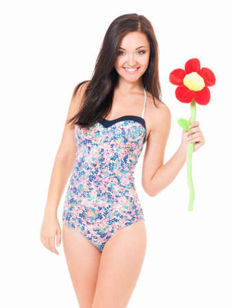 tantalising: Beautiful young woman in swimsuit with big flower, isolated over white background Stock Photo