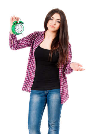 school exam: Depression teen student girl with green alarm clock, isolated over white background Stock Photo