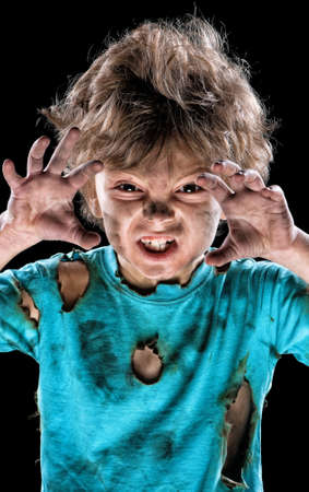 Boy has a electric shock. Portrait of funny little electrician over black background. Electricity power concept.