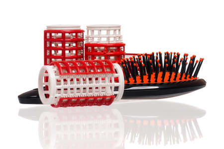 Plastic hairbrush with hair curlers, isolated on white background. Women tools for creating a beautiful hairstyle from ringlets.