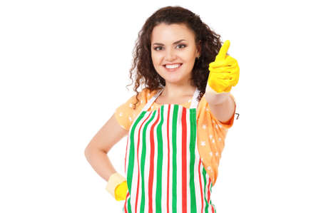 houseclean: Beautiful young housewife with yellow latex cleaning gloves. Young happy woman put on hand yellow rubber glove, looking at camera and doing a thumb up gesture, isolated on white background.