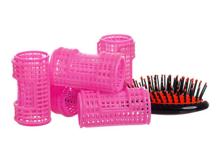 ringlets: Plastic hairbrush with hair curlers, isolated on white background. Women tools for creating a beautiful hairstyle from ringlets.