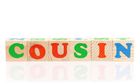 cousin: Cousin word formed by colorful wooden alphabet blocks, isolated on white background Stock Photo