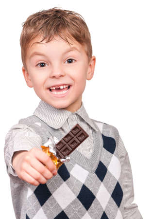 smudgy: Funny little boy eating chocolate. He is smudged with chocolate. Child isolated on white background.