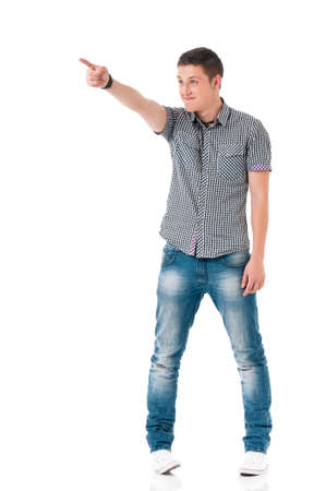 forefinger: Full length portrait of a successful young man showing something, isolated on white background