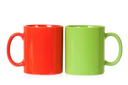 cupping glass cupping: Two mugs - green and red - for coffee or tea, isolated on white background
