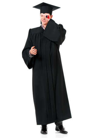 Portrait of man in an academic gown holding a diploma - graduate guy student, isolated on white background  Stock Photo