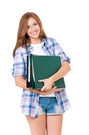 Beautiful teen girl with folders, isolated on white background  Stock Photo