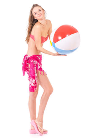 Pretty girl posing in bikini with beach ball, isolated on white background