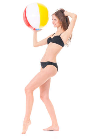 Pretty girl posing in black bikini with beach ball, isolated on white background Stock Photo