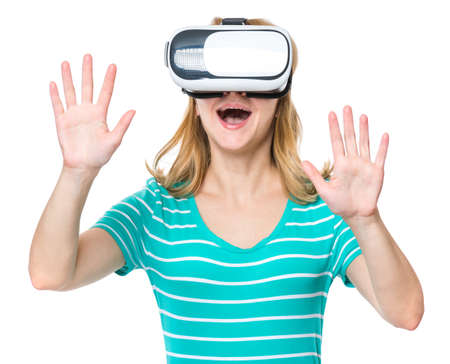 Amazed woman wearing virtual reality goggles watching movies or playing video games. Female getting experience using VR-headset glasses of virtual reality at home much gesticulating hands.
