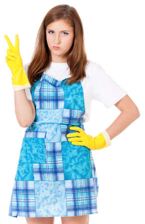 closet: Young housewife with yellow gloves making victory gesture, isolated on white background