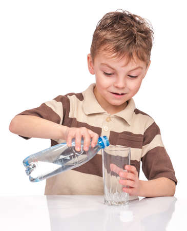 Portrait of cheerful little boy with glass and plastic bottle of water. Cute smiling child drinks water, isolated on white background. photo