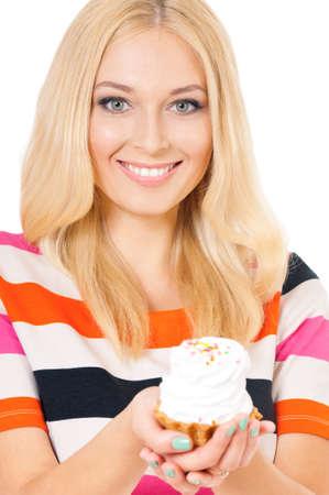 Closeup of smiling woman eating sweet cake on white background Reklamní fotografie