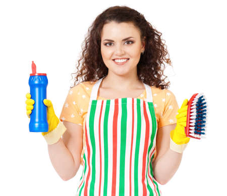 smiling young woman holding bottle of chemistry for cleaning