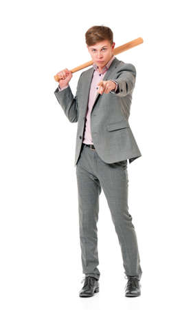 Anger man in suit with wooden baseball bat. Guy standing and pointing at camera choosing you - full length portrait, isolated on white background. Stock Photo