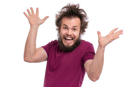 Crazy bearded Man with funny Haircut, isolated on white background. Happy guy screaming and keeping mouth open. Emotions and signs concept. Фото со стока
