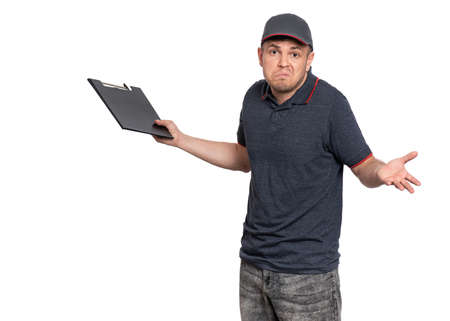 Portrait of unhappy Delivery man in cap holding clipboard with papers document. Confused handsome man looking on camera. Sad courier isolated on white background.