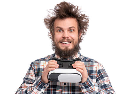 Crazy bearded Man in plaid shirt with funny Haircut wearing virtual reality helmet, isolated on white background. Portrait of funny happy man using VR goggles.