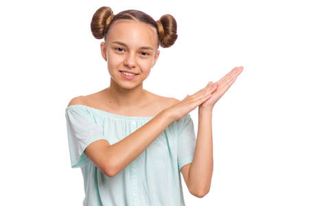 Emotional portrait of caucasian smiling teen girl clapping hands. Happy child joyfully, isolated white background. Beautiful funny teenager giving applause.
