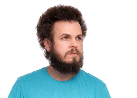 Crazy bearded Man with funny Curly Hair, isolated on white background. Looking away. Emotions and signs concept.