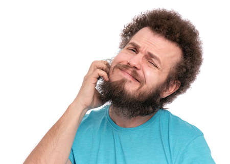 Crazy bearded Man with funny Curly Hair scratching messy beard, isolated on white background. Emotions and signs concept.