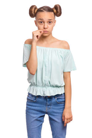 Portrait of teen girl showing sign of closing mouth and silence gesture. My lips are sealed. Child showing zip gesture as if shutting mouth on key. Funny teenager isolated on white background.