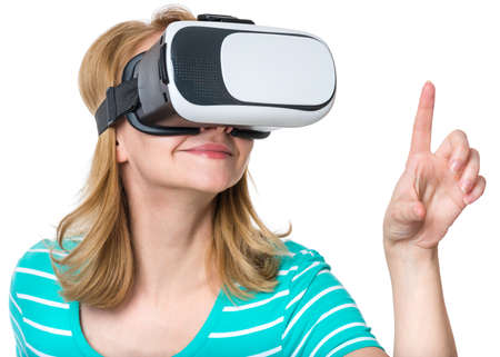 Young Woman in Virtual Reality Glasses, isolated on white background. Beautiful Girl touching air during using VR device. Female play game though VR headset.