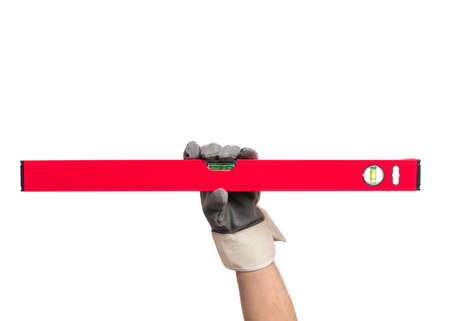 Male Hand wearing Working Glove with red bubble level tool. Human Hand holding building and engineering measure equipment, Isolated on White Background.