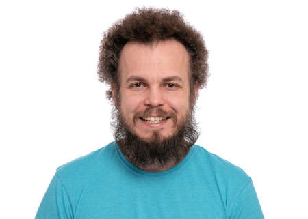 Happy crazy bearded Man with funny Curly Hair, isolated on white background. Looking at camera and smiling. Emotions and signs concept.