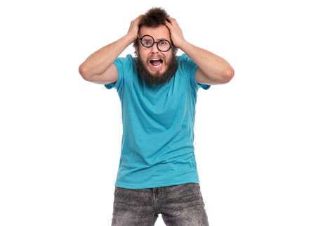 Crazy Scared or Surprised Man with funny Curly Hair in eye Glasses, looks worried. Bearded guy afraid and shocked, isolated on white background. Emotions and signs concept.