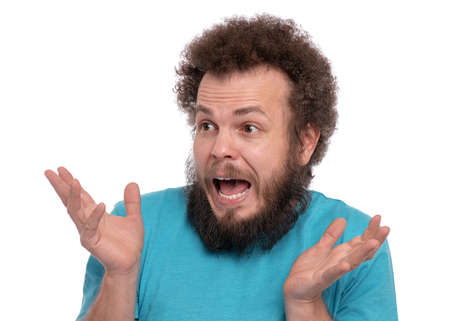 Portrait of bearded man with funny curly hair, isolated on white background. Surprised or Shocked guy looking away, keeping mouth open. Emotions and signs concept.