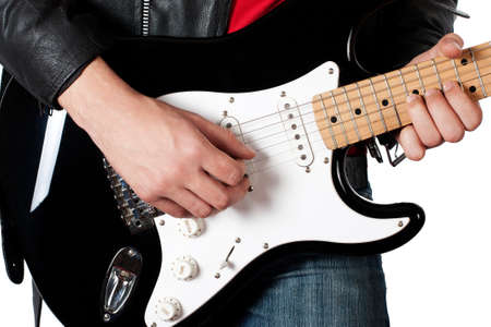 a guitarist boy playing guitar: Young guy in leather jacket playing electric guitar on white Stock Photo
