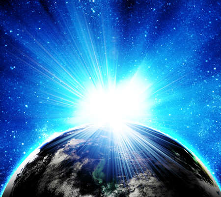 sun rising: blue earth in space with rising sun