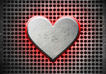 Metal heart on a metal background Stock Photo - 12691245